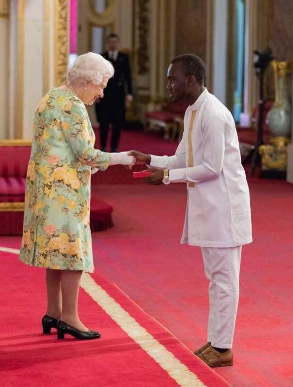 Derick Omari from Tech Era meeting the Queen