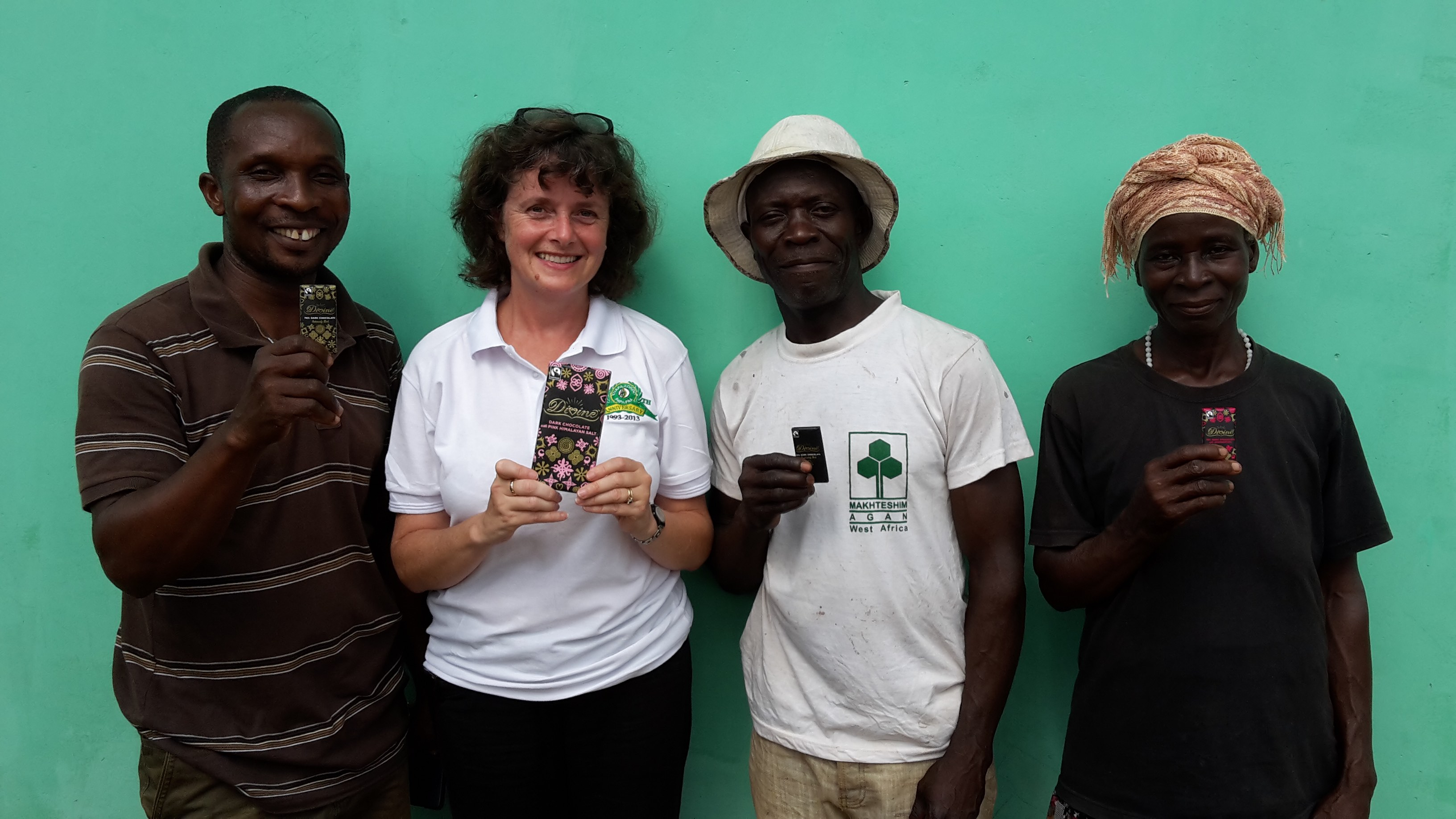 Divine Sophi Tranchell with co-op farmers.jpg