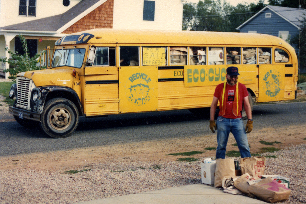 Eco-Cycle worker and bus