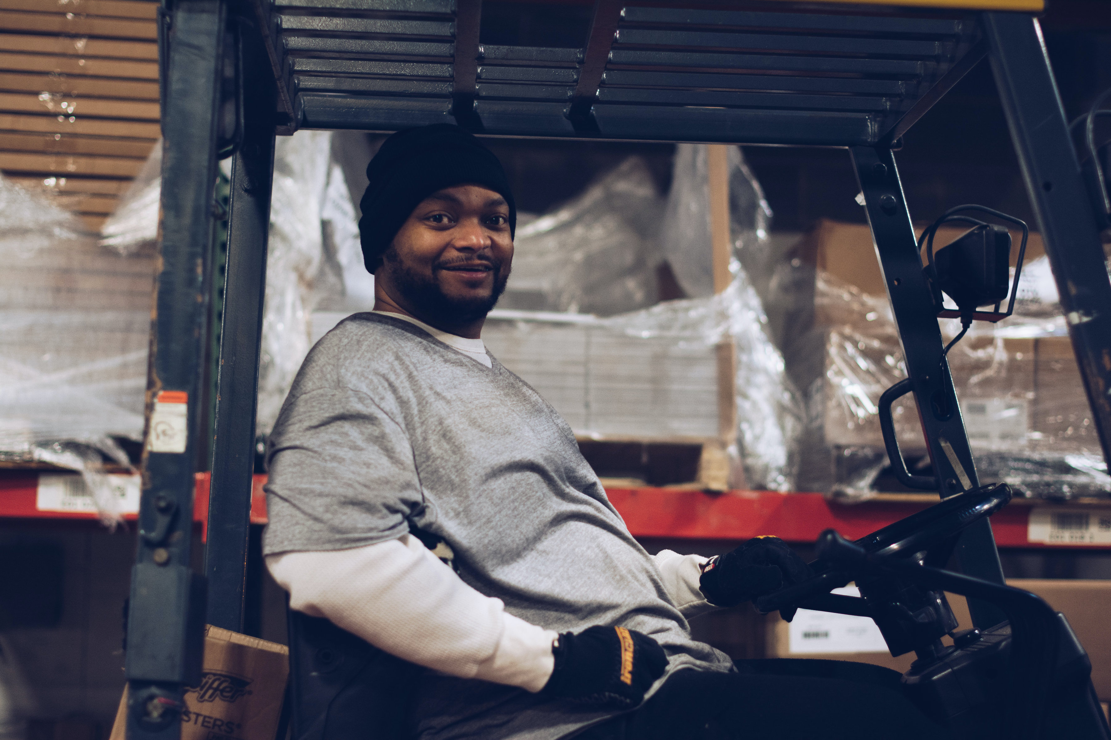 Man working in a warehouse supported by First Step Staffing. The non-profit helps people facing barriers to employment find jobs