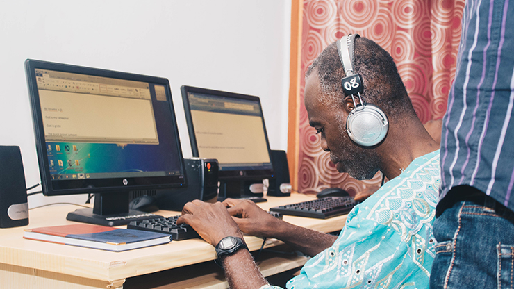 Tech Era training a visually impaired teacher to use a computer