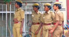Trainee police women outside a temple