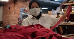 A volunteer makes face shields at the Biji biji Initiative in Malaysia