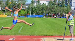 An athlete does long jump