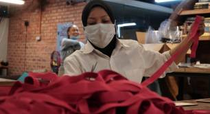 A volunteer makes face shields at the Biji biji Initiative in Malaysia