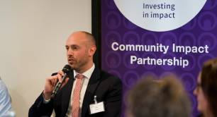 Sam Scharf Community Impact Partnership Orbit