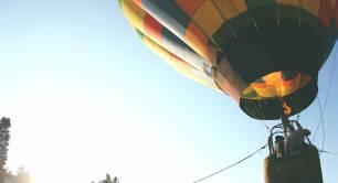 hot air balloon on its way up