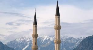 Minarets against a backdrop of mountain peaks