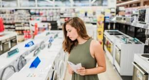 Woman buying washing machine