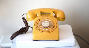Yellow vintage telephone
